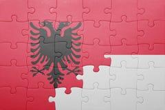 Γρίφος με τη εθνική σημαία της Ινδονησίας και της Αλβανίας Στοκ φωτογραφίες με δικαίωμα ελεύθερης χρήσης