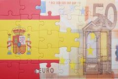 Γρίφος με τη εθνική σημαία της Ισπανίας και του ευρο- τραπεζογραμματίου Στοκ φωτογραφία με δικαίωμα ελεύθερης χρήσης