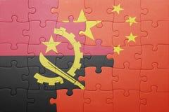 Γρίφος με τη εθνική σημαία της Κίνας και της Ανγκόλα Στοκ Εικόνες