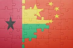 Γρίφος με τη εθνική σημαία της Κίνας και της Γουινέα-Μπισσάου Στοκ Φωτογραφίες