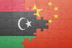 Γρίφος με τη εθνική σημαία της Κίνας και της Λιβύης Στοκ Φωτογραφίες