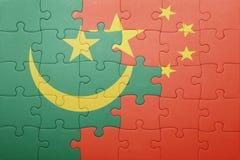 Γρίφος με τη εθνική σημαία της Κίνας και της Μαυριτανίας Στοκ Φωτογραφία