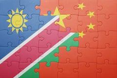 γρίφος με τη εθνική σημαία της Κίνας και της Ναμίμπια Στοκ Φωτογραφία