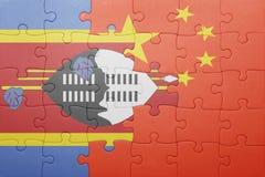γρίφος με τη εθνική σημαία της Κίνας και της Σουαζηλάνδης Στοκ εικόνα με δικαίωμα ελεύθερης χρήσης