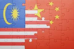 Γρίφος με τη εθνική σημαία της Κίνας και της Μαλαισίας Στοκ Φωτογραφία