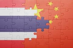Γρίφος με τη εθνική σημαία της Κίνας και της Ταϊλάνδης Στοκ Φωτογραφία