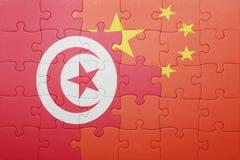 Γρίφος με τη εθνική σημαία της Κίνας και της Τυνησίας Στοκ φωτογραφία με δικαίωμα ελεύθερης χρήσης