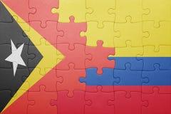 Γρίφος με τη εθνική σημαία της Κολομβίας και ανατολικού Timor Στοκ φωτογραφία με δικαίωμα ελεύθερης χρήσης