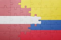 Γρίφος με τη εθνική σημαία της Κολομβίας και της Λετονίας Στοκ Εικόνες