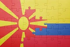 Γρίφος με τη εθνική σημαία της Κολομβίας και της Μακεδονίας Στοκ εικόνες με δικαίωμα ελεύθερης χρήσης