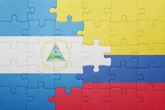 Γρίφος με τη εθνική σημαία της Κολομβίας και της Νικαράγουας Στοκ φωτογραφίες με δικαίωμα ελεύθερης χρήσης