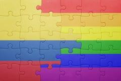 Γρίφος με τη εθνική σημαία της Κολομβίας και την ομοφυλοφιλική σημαία Στοκ Φωτογραφία