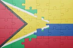 Γρίφος με τη εθνική σημαία της Κολομβίας και της Γουιάνας Στοκ Εικόνες
