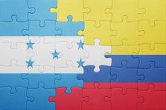 Γρίφος με τη εθνική σημαία της Κολομβίας και της Ονδούρας Στοκ φωτογραφίες με δικαίωμα ελεύθερης χρήσης