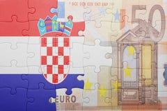 Γρίφος με τη εθνική σημαία της Κροατίας και του ευρο- τραπεζογραμματίου Στοκ εικόνα με δικαίωμα ελεύθερης χρήσης