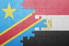 γρίφος με τη εθνική σημαία της λαϊκής δημοκρατίας του Κογκό και της Αιγύπτου Στοκ Εικόνες