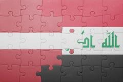 γρίφος με τη εθνική σημαία της Λετονίας και του Ιράκ Στοκ φωτογραφία με δικαίωμα ελεύθερης χρήσης