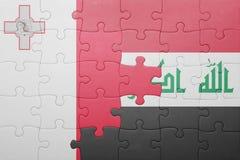γρίφος με τη εθνική σημαία της Μάλτας και του Ιράκ Στοκ Φωτογραφίες