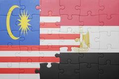 γρίφος με τη εθνική σημαία της Μαλαισίας και της Αιγύπτου Στοκ φωτογραφίες με δικαίωμα ελεύθερης χρήσης