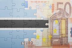 Γρίφος με τη εθνική σημαία της Μποτσουάνα και του ευρο- τραπεζογραμματίου Στοκ φωτογραφία με δικαίωμα ελεύθερης χρήσης