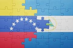 Γρίφος με τη εθνική σημαία της Νικαράγουας και της Βενεζουέλας Στοκ εικόνα με δικαίωμα ελεύθερης χρήσης