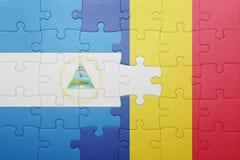 γρίφος με τη εθνική σημαία της Νικαράγουας και της Ρουμανίας Στοκ φωτογραφία με δικαίωμα ελεύθερης χρήσης