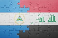 Γρίφος με τη εθνική σημαία της Νικαράγουας και του Ιράκ Στοκ εικόνα με δικαίωμα ελεύθερης χρήσης