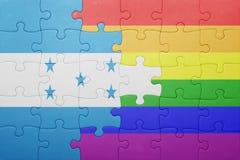 Γρίφος με τη εθνική σημαία της Ονδούρας και την ομοφυλοφιλική σημαία Στοκ εικόνα με δικαίωμα ελεύθερης χρήσης