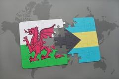 γρίφος με τη εθνική σημαία της Ουαλίας και των Μπαχαμών σε έναν παγκόσμιο χάρτη Στοκ Φωτογραφίες