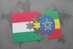 γρίφος με τη εθνική σημαία της Ουγγαρίας και της Αιθιοπίας σε έναν παγκόσμιο χάρτη Στοκ Εικόνες