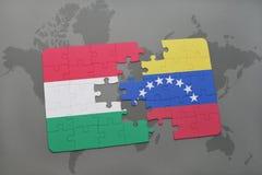 γρίφος με τη εθνική σημαία της Ουγγαρίας και της Βενεζουέλας σε έναν παγκόσμιο χάρτη Στοκ Εικόνες
