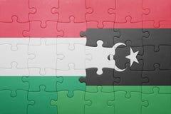 γρίφος με τη εθνική σημαία της Ουγγαρίας και της Λιβύης Στοκ φωτογραφία με δικαίωμα ελεύθερης χρήσης