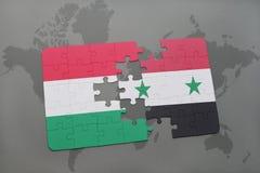 γρίφος με τη εθνική σημαία της Ουγγαρίας και της Συρίας σε έναν παγκόσμιο χάρτη Στοκ Εικόνες