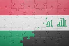Γρίφος με τη εθνική σημαία της Ουγγαρίας και του Ιράκ Στοκ Εικόνα