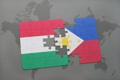 γρίφος με τη εθνική σημαία της Ουγγαρίας και των Φιλιππινών σε έναν παγκόσμιο χάρτη Στοκ Εικόνες