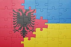 γρίφος με τη εθνική σημαία της Ουκρανίας και της Αλβανίας Στοκ Εικόνες