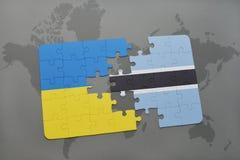 γρίφος με τη εθνική σημαία της Ουκρανίας και της Μποτσουάνα σε έναν παγκόσμιο χάρτη Στοκ Εικόνες