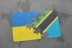 γρίφος με τη εθνική σημαία της Ουκρανίας και της Τανζανίας σε έναν παγκόσμιο χάρτη Στοκ Εικόνες