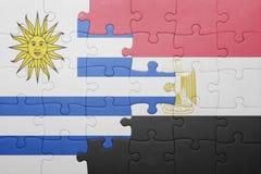 γρίφος με τη εθνική σημαία της Ουρουγουάης και της Αιγύπτου Στοκ Φωτογραφίες