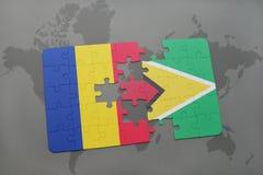 γρίφος με τη εθνική σημαία της Ρουμανίας και της Γουιάνας σε έναν παγκόσμιο χάρτη Στοκ Εικόνα