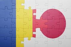 Γρίφος με τη εθνική σημαία της Ρουμανίας και της Ιαπωνίας Στοκ φωτογραφία με δικαίωμα ελεύθερης χρήσης