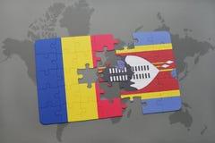 γρίφος με τη εθνική σημαία της Ρουμανίας και της Σουαζηλάνδης σε έναν παγκόσμιο χάρτη Στοκ Φωτογραφίες
