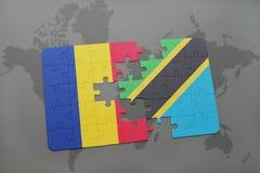 γρίφος με τη εθνική σημαία της Ρουμανίας και της Τανζανίας σε έναν παγκόσμιο χάρτη Στοκ Εικόνα