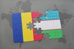 γρίφος με τη εθνική σημαία της Ρουμανίας και του Ουζμπεκιστάν σε έναν παγκόσμιο χάρτη Στοκ φωτογραφία με δικαίωμα ελεύθερης χρήσης