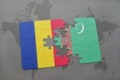 γρίφος με τη εθνική σημαία της Ρουμανίας και του Τουρκμενιστάν σε έναν παγκόσμιο χάρτη Στοκ Εικόνες