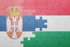 Γρίφος με τη εθνική σημαία της Σερβίας και της Ουγγαρίας Στοκ εικόνες με δικαίωμα ελεύθερης χρήσης