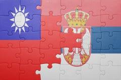 Γρίφος με τη εθνική σημαία της Ταϊβάν και της Σερβίας Έννοια Στοκ Εικόνα