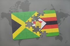 γρίφος με τη εθνική σημαία της Τζαμάικας και της Ζιμπάπουε σε έναν παγκόσμιο χάρτη Στοκ εικόνες με δικαίωμα ελεύθερης χρήσης