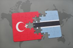 γρίφος με τη εθνική σημαία της Τουρκίας και της Μποτσουάνα σε έναν παγκόσμιο χάρτη Στοκ φωτογραφία με δικαίωμα ελεύθερης χρήσης