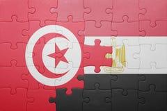 γρίφος με τη εθνική σημαία της Τυνησίας και της Αιγύπτου Στοκ φωτογραφία με δικαίωμα ελεύθερης χρήσης
